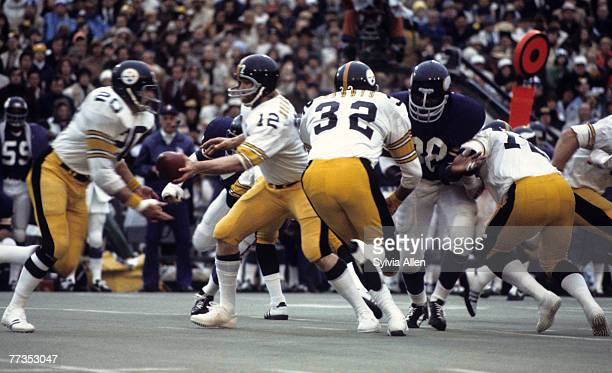 Hall of Fame quarterback Terry Bradshaw of the Pittsburgh Steelers prepares to handoff to running back Rocky Bleier during the Steelers 166 victory...