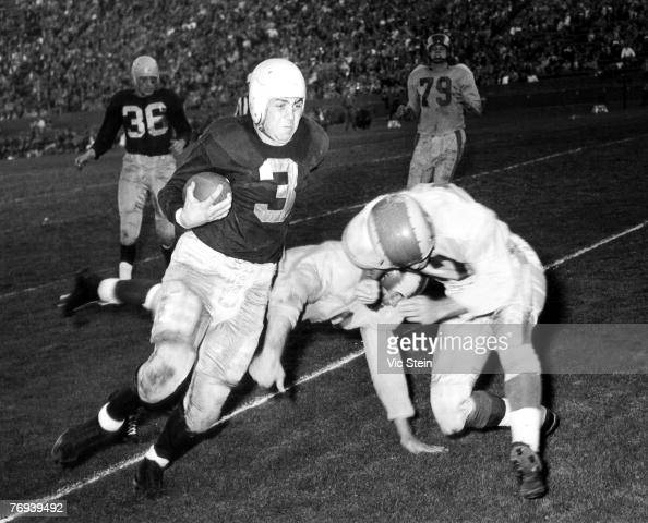 Hall of Fame running back Tony Canadeo of the Green Bay Packers gets by two defenders on a run Vic Stein
