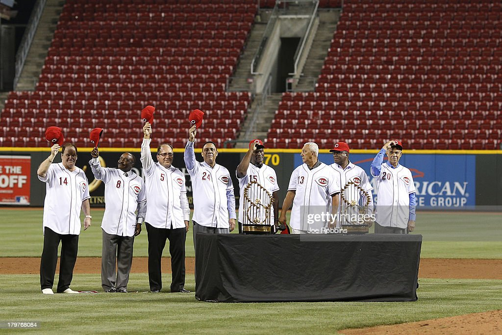 Hall of fame second baseman <a gi-track='captionPersonalityLinkClicked' href=/galleries/search?phrase=Joe+Morgan&family=editorial&specificpeople=208135 ng-click='$event.stopPropagation()'>Joe Morgan</a> (2L) acknowledges the crowd along with former members of the Big Red Machine teams of the 1970s in a ceremony following the game between the Cincinnati Reds and Los Angeles Dodgers at Great American Ball Park on September 6, 2013 in Cincinnati, Ohio. The Reds won 3-2.