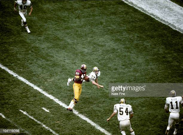 Hall of Fame wide receiver Charley Taylor of the Washington Redskins catches a touchdown pass during the Redskins 413 victory over the New Orleans...