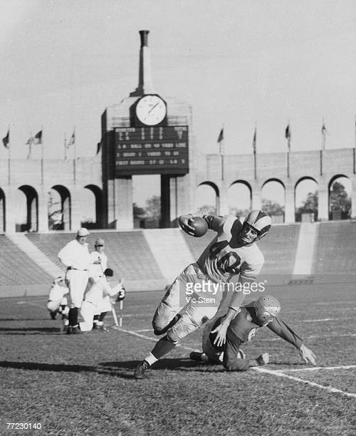 Hall of Fame wide receiver Elroy 'Crazylegs' Hirsch of the Los Angeles Rams gets knocked out of bounds from a San Francisco 49ers tackler in a 28 to...