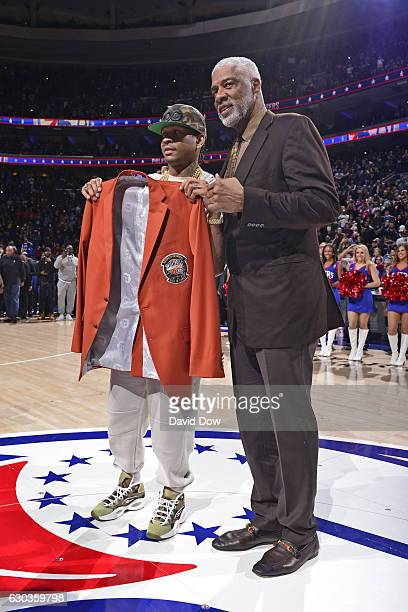 Hall of Famer Allen Iverson receives his jacket from NBA Legend Julius Erving before the Los Angeles Lakers game against the Philadelphia 76ers at...