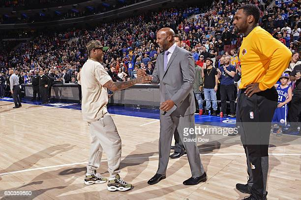 Hall of Famer Allen Iverson shakes hands with Brian Shaw of the Los Angeles Lakers before the game against the Philadelphia 76ers at the Wells Fargo...