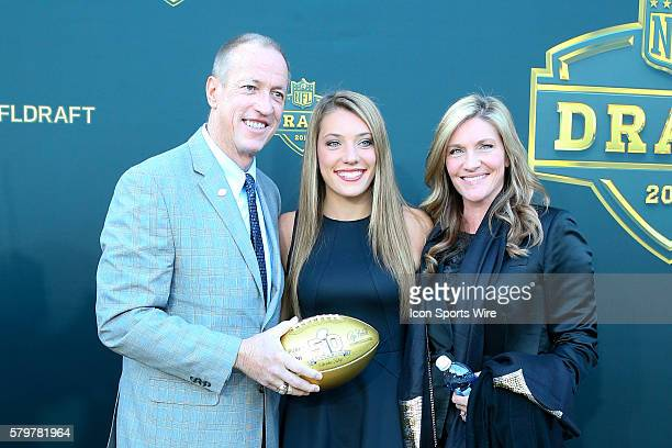 Hall of Famer and Buffalo Bill Quarterback Jim Kelly and his wife Jill and daughter Erin carries a Gold Football on the Gold Carpet at the 2015...