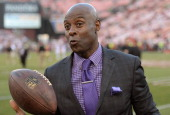 Hall of Famer and former San Francisco 49er Jerry Rice catches passes prior to the start of an NFL Football game between the 49ers and Atlanta...