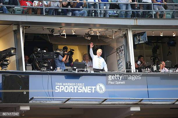 Hall of Famer and Los Angeles Dodgers announcer Vin Scully waves in thanks and appreciation of support as fans cheer and give him a standing ovation...