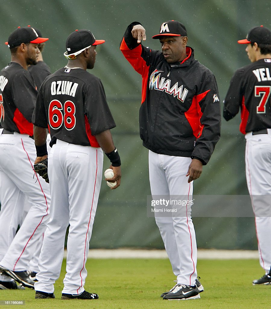 Hall of Famer Andre Dawson gives some pointers to outfielder Marcel Ozuna on the first day of full squad workouts at Miami Marlins spring training camp at Roger Dean Stadium in Jupiter, Florida, Friday, February 15, 2013.