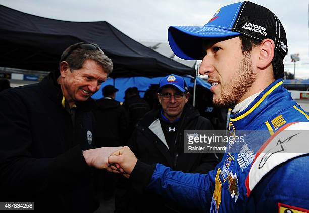 Hall of Famer Bill Elliott congratulates his son Chase Elliott driver of the NAPA AUTO PARTS Chevrolet after qualifying for the NASCAR Sprint Cup...
