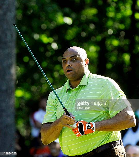 Hall of Famer Charles Barkley watches his broken club head tumble down the first fairway during the Regions Tradition NCR ProAm at Shoal Creek on May...