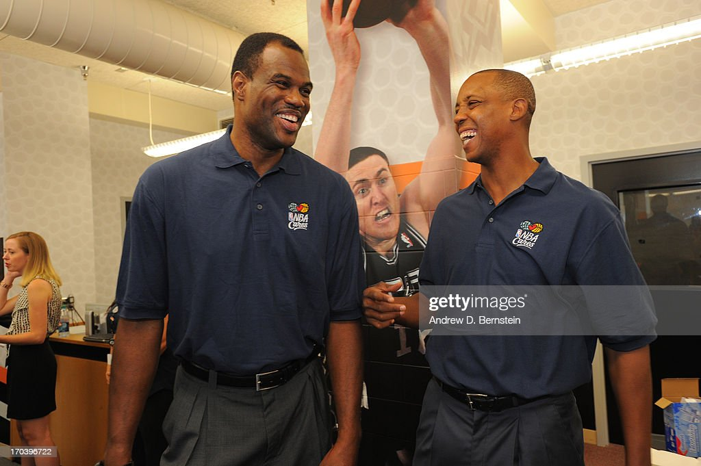 Hall of Famer David Robinson chats with former teammate Sean Elliott of the San Antonio Spurs at the 2013 NBA Cares Legacy Project as part of the 2013 NBA Finals on June 7, 2013 at the Wheatley Middle School in San Antonio, Texas.