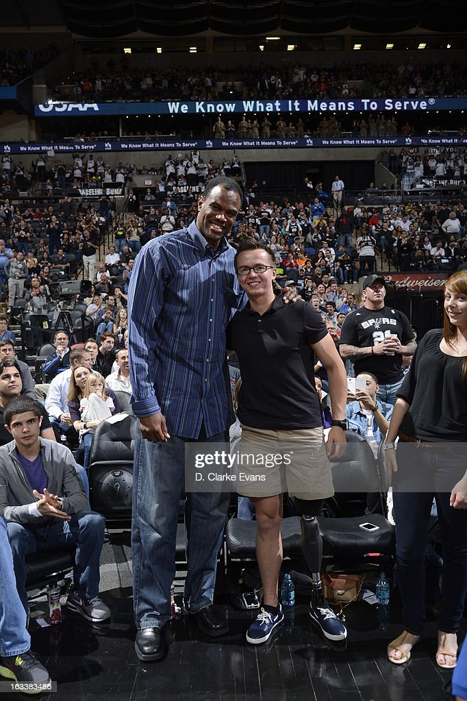 NBA Hall of Famer David Robinson poses for a picture with a fan on MARCH 8, 2013 at the AT&T Center in San Antonio, Texas.