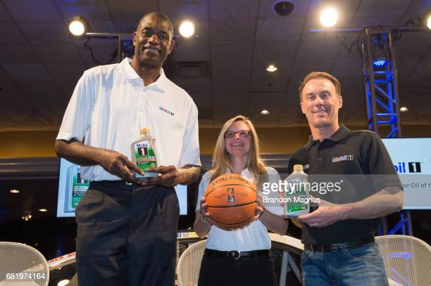 NBA Hall of Famer Dikembe Mutombo Michele Biamonte automotive marketing manager for ExxonMobil and Kevin Harvick driver of the Mobil 1 Annual...