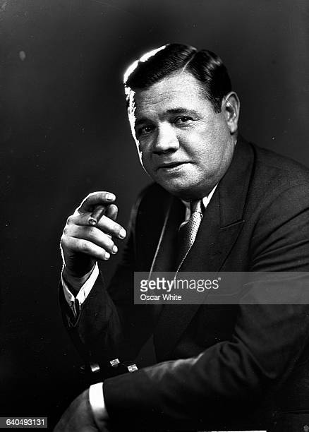 Hall of Famer George Herman 'Babe' Ruth poses with a cigar Ruth set both pitching and homerun records during his baseball career playing for the...