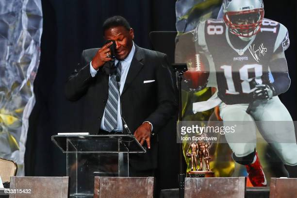 Hall of Famer Jackie Slater wipes away tears as he speaks to the audience after he receives the Bart Starr Award for his son New England Patriots...