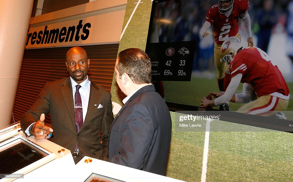 NFL Hall of Famer Jerry Rice (L) speaks near Super Bowl XLVII Radio Row at the Ernest N. Morial Convention Center on January 31, 2013 in New Orleans, Louisiana.