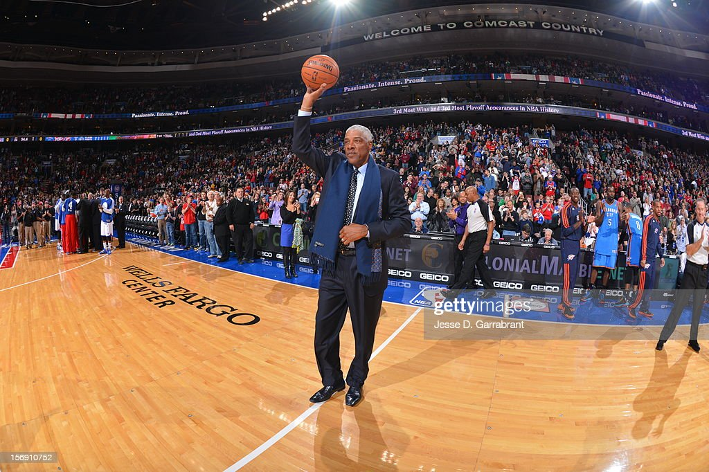 Hall of Famer Julius Erving gives the ball to the refs at the Wells Fargo Center on November 24, 2012 in Philadelphia, Pennsylvania.
