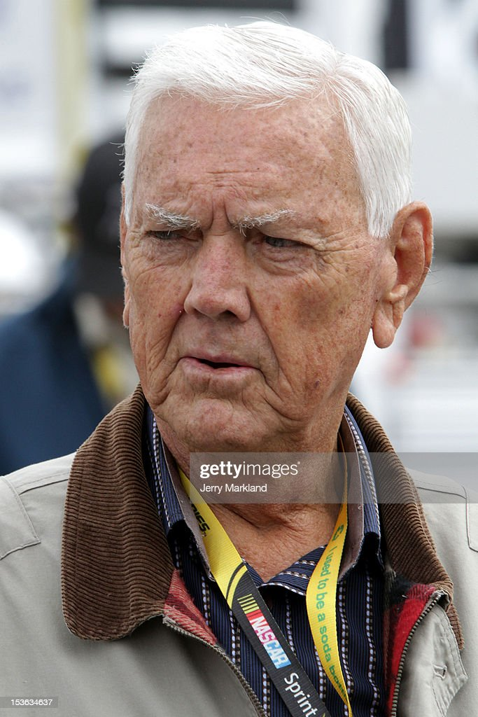 Hall of Famer Junior Johnson looks on from the grid prior to the start of the NASCAR Sprint Cup Series Good Sam Roadside Assistance 500 at Talladega Superspeedway on October 7, 2012 in Talladega, Alabama.