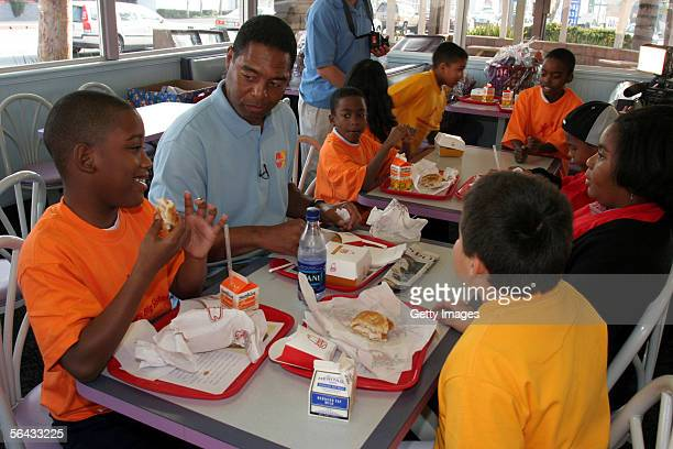 Hall of Famer Marcus Allen shares breakfast with children from the local Big Brothers and Big Sisters chapter at an Arby's as part of a holiday...