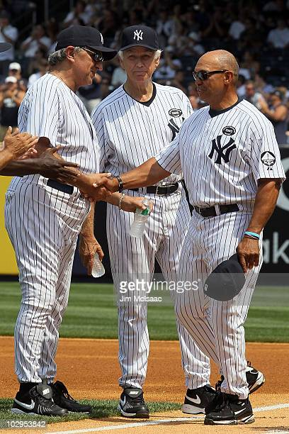 Hall of Famer Reggie Jackson shakes hands with Joe Pepitone during the New York Yankees 64th OldTimer's Day before the MLB game against the Tampa Bay...
