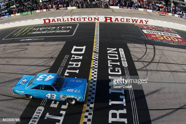 Hall of Famer Richard Petty drives the STP Plymouth prior to the Monster Energy NASCAR Cup Series Bojangles' Southern 500 at Darlington Raceway on...