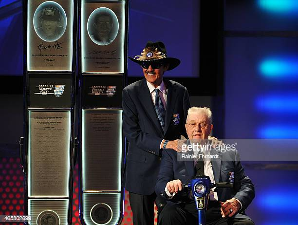 Hall of Famer Richard Petty presents his brother Maurice Petty as a 2014 inductee into the NASCAR Hall of Fame during an induction ceremony at...