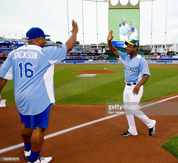 Hall of Famer Rickey Henderson laughs is greeted by former MLB AllStar Bo Jackson during the opening ceremony before the 2012 Taco Bell AllStar...
