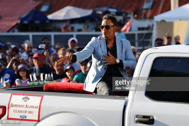 Hall of Famer Roberto Alomar arrives during the 2017 Hall of Fame Parade of Legends at the National Baseball Hall of Fame on Saturday July 29 2017 in...