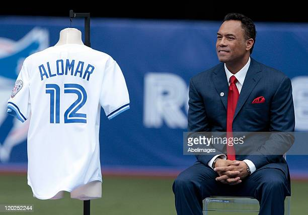 Hall of Famer Roberto Alomar listens to the fans during a ceremony to retire his before MLB action at the Rogers Centre July 31 2011 in Toronto...