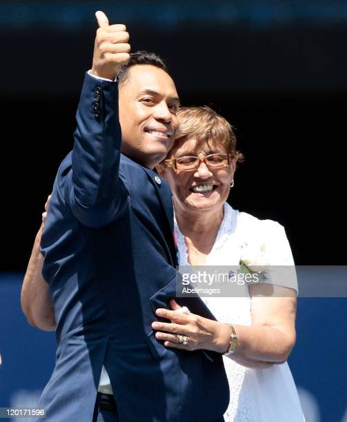 Hall of Famer Roberto Alomar waves to the fans with his mother Maria Alomar during a ceremony to retire his jersey at the Rogers Centre July 31 2011...