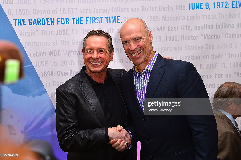Hall of Famer ÒRowdyÓ Roddy Piper and NY Rangers Legend <a gi-track='captionPersonalityLinkClicked' href=/galleries/search?phrase=Mark+Messier&family=editorial&specificpeople=201793 ng-click='$event.stopPropagation()'>Mark Messier</a> attend Madison Square Garden's 'Garden 366' And 'Defining Moments' Exhibition Openings at Madison Square Park on October 11, 2012 in New York City.