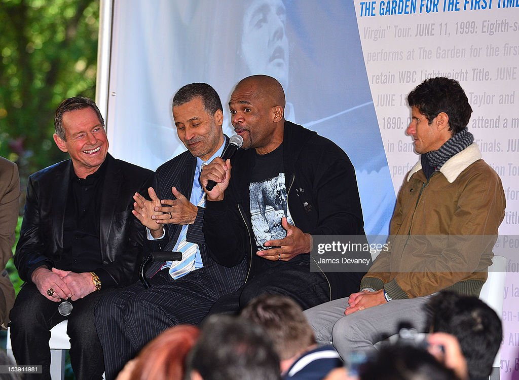 Hall of Famer ÒRowdyÓ Roddy Piper, Run DMC <a gi-track='captionPersonalityLinkClicked' href=/galleries/search?phrase=Darryl+McDaniels&family=editorial&specificpeople=175934 ng-click='$event.stopPropagation()'>Darryl McDaniels</a> and Beastie Boys Mike D attends Madison Square Garden's 'Garden 366' And 'Defining Moments' Exhibition Openings at Madison Square Park on October 11, 2012 in New York City.