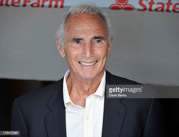 Hall of Famer Sandy Koufax stands in the Los Angeles Dodgers dugout before the game against the Chicago Cubs on August 1 2013 at Wrigley Field in...