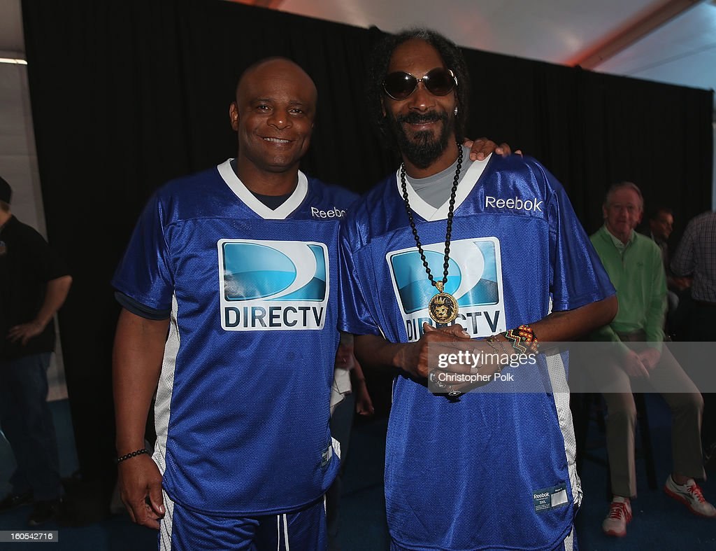 Hall of Famer Warren Moon (L) and Rapper Snoop Dogg attend DIRECTV'S Seventh Annual Celebrity Beach Bowl at DTV SuperFan Stadium at Mardi Gras World on February 2, 2013 in New Orleans, Louisiana.