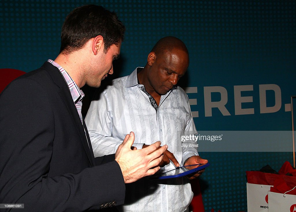 Hall of Famer Warren Moon poses with Motorola Xoom at the Maxim Party Powered by Motorola Xoom at Centennial Hall at Fair Park on February 5, 2011 in Dallas, Texas.