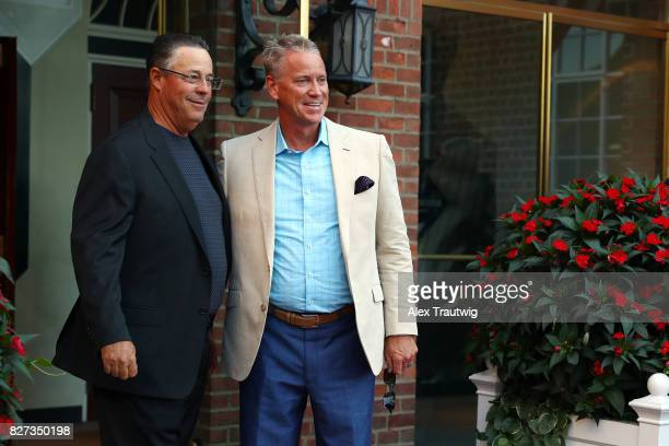 Hall of Famers Greg Maddux and Tom Glavine arrive during the 2017 Hall of Fame Parade of Legends at the National Baseball Hall of Fame on Saturday...