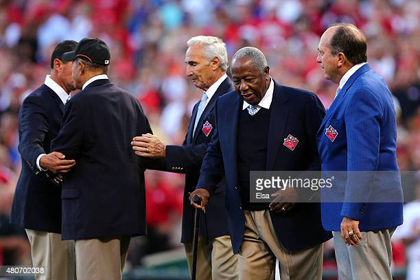 Hall of Famers Hank Aaron Johnny Bench Sandy Koufax and Willie Mays walk on the field prior to the 86th MLB AllStar Game at the Great American Ball...