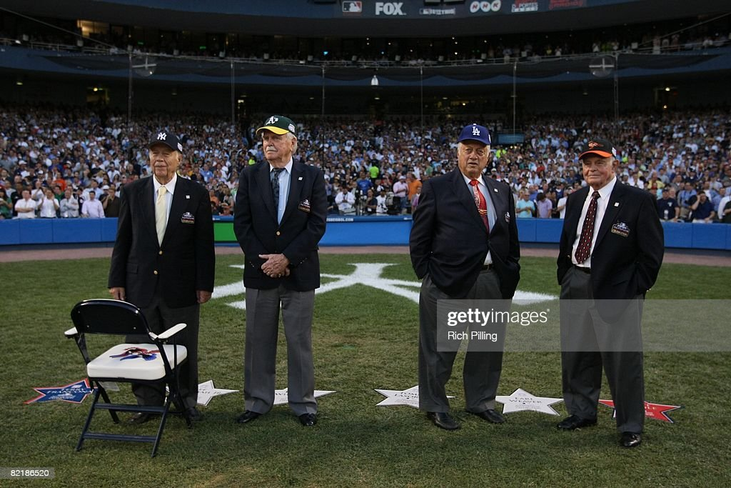 Hall of Famers Lee McPhail, Jr., Dick Williams, Tommy Lasorda, and Earl Weaver stand on the field before the 79th MLB All-Star Game at the Yankee Stadium in the Bronx, New York on July 15, 2008. The American League defeated the National League 4-3.