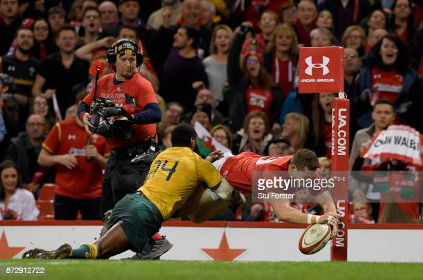 Hallam Amos of Wales touches down for the second try as Marika Koroibete of Australia attempts to stop him during the Under Armour Series match...