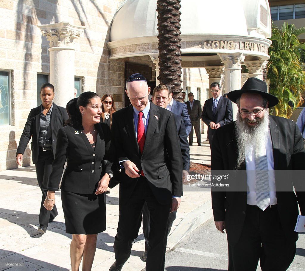 Hallandale Beach Mayor Joy Cooper, Florida Governor <a gi-track='captionPersonalityLinkClicked' href=/galleries/search?phrase=Rick+Scott+-+Pol%C3%ADtico&family=editorial&specificpeople=2370892 ng-click='$event.stopPropagation()'>Rick Scott</a> and Rabbi Raphael Tennenhaus visit Chabad of South Broward on December 17, 2014 in Hallandale, Florida.