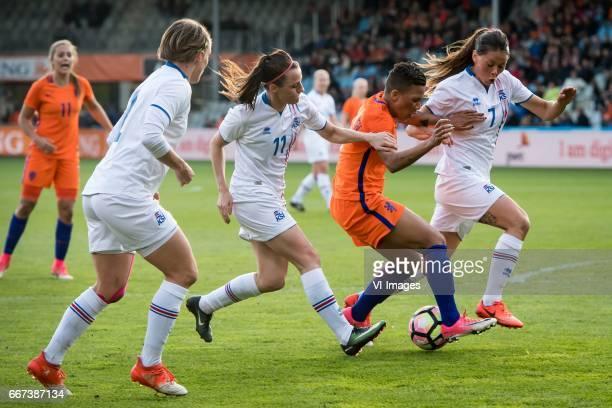 Hallbera Gudny Gisladottir of Iceland Shanice van de Sanden of the Netherlands Sara Bjork Gunnarsdottir of Icelandduring the friendly match between...