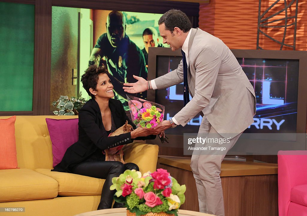 Halle Berry and Alan Tacher appear on Univision's Despierta America to promote her film 'The Call' at Univision Headquarters on February 27, 2013 in Miami, Florida.