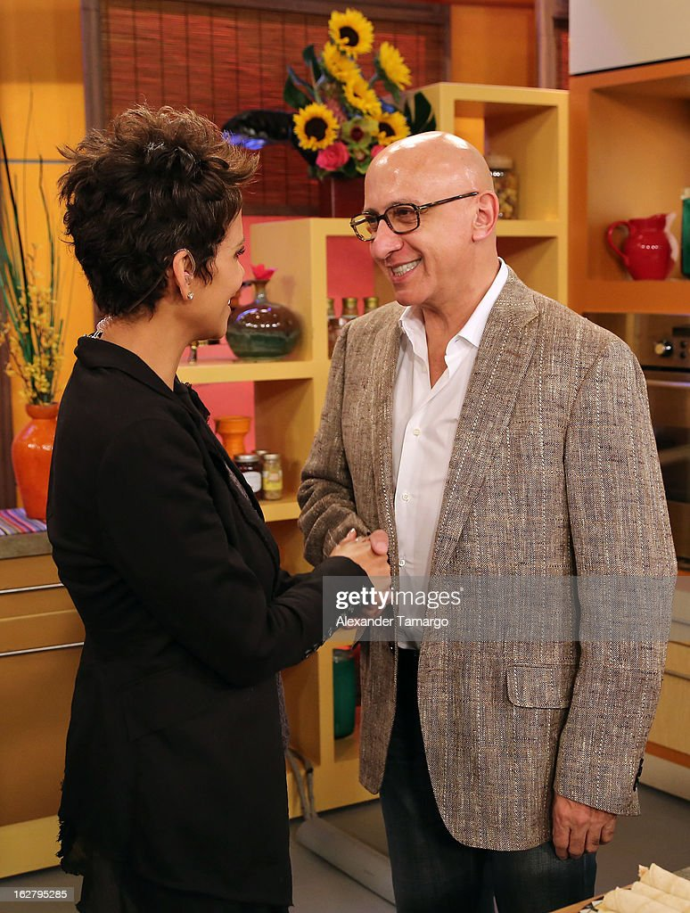 Halle Berry and Alberto Ciruana appear on Univision's Despierta America to promote her film 'The Call' at Univision Headquarters on February 27, 2013 in Miami, Florida.