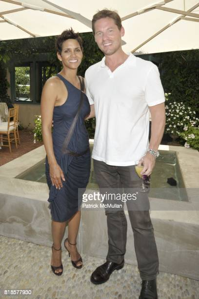 Halle Berry and David Zinczenko attend Halle Berry Ronald Perelman and REVLON host a luncheon for The JENESSE CENTER at Private Residence on August...