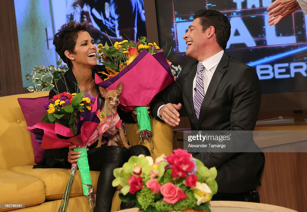 Halle Berry and Johnny Lozada appear on Univision's Despierta America to promote her film 'The Call' at Univision Headquarters on February 27, 2013 in Miami, Florida.