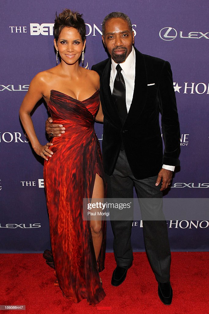 <a gi-track='captionPersonalityLinkClicked' href=/galleries/search?phrase=Halle+Berry&family=editorial&specificpeople=201726 ng-click='$event.stopPropagation()'>Halle Berry</a> and Louis Carr attend BET Honors 2013: Red Carpet Presented By Pantene at Warner Theatre on January 12, 2013 in Washington, DC.