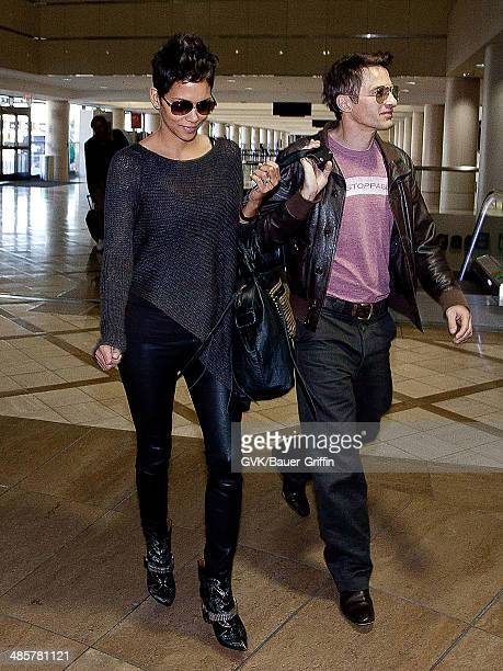 Halle Berry and Olivier Martinez are seen at Los Angeles International Airport on February 16 2013 in Los Angeles California