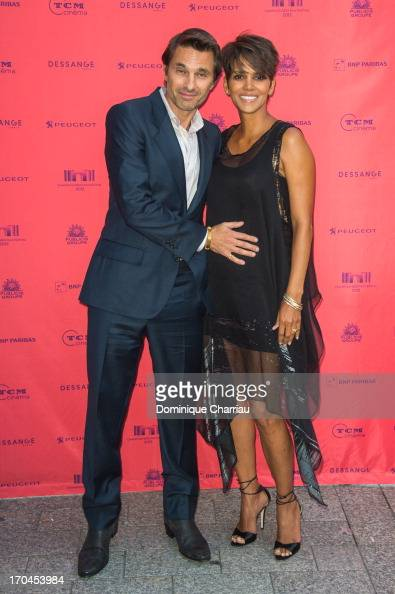 Halle Berry and Olivier Martinez attend the 'Toiles Enchantees' Red Carpet as part of the Champs Elysees Film Festival 2013 at Publicis Champs...