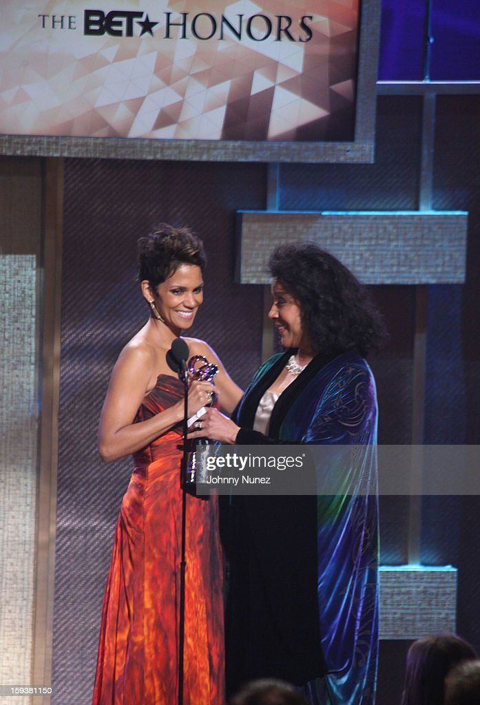 <a gi-track='captionPersonalityLinkClicked' href=/galleries/search?phrase=Halle+Berry&family=editorial&specificpeople=201726 ng-click='$event.stopPropagation()'>Halle Berry</a> and <a gi-track='captionPersonalityLinkClicked' href=/galleries/search?phrase=Phylicia+Rashad&family=editorial&specificpeople=206924 ng-click='$event.stopPropagation()'>Phylicia Rashad</a> attend BET Honors 2013 at Warner Theatre on January 12, 2013 in Washington, DC.