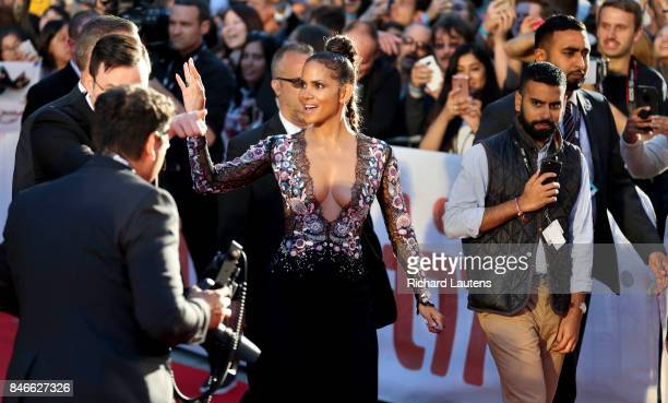 TORONTO ON SEPTEMBER 13 Halle Berry rocks the red carpet Movie Kings held a red carpet before the screening at Roy Thomson Hall for TIFF Expected...