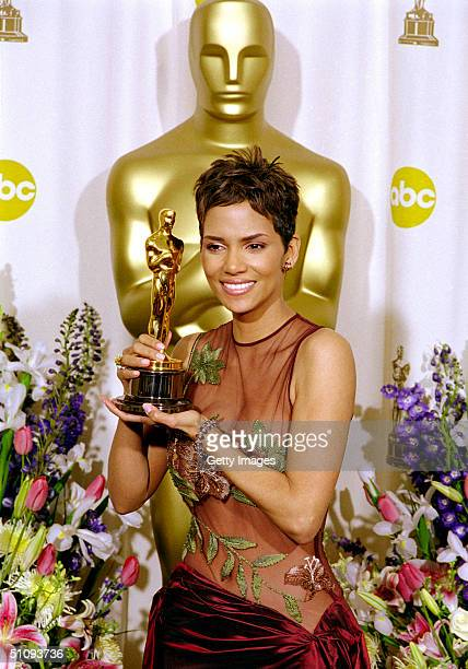 Halle Berry Winner Of The Best Actress Academy Award For Her Performance In The Film 'Monsters Ball' Poses For Photographs With Her Award Backstage...